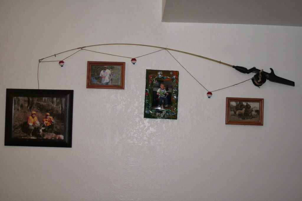 Man cave, fishing pole, pictures