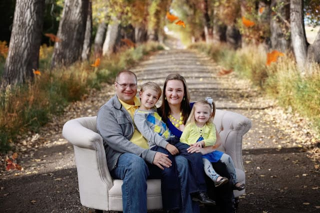 Yellow and blue family photos, fall family photos, family photo poses with couch, casual family photos, Krista Haffner Photography