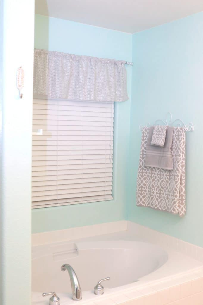 master bathroom makeover, wood wall behind toilet, grey and aqua bathroom, affordable bathroom makeover, bathroom makeover on a budget, budget friendly bathroom makeover, how to paint cabinets, how to use frogtape®