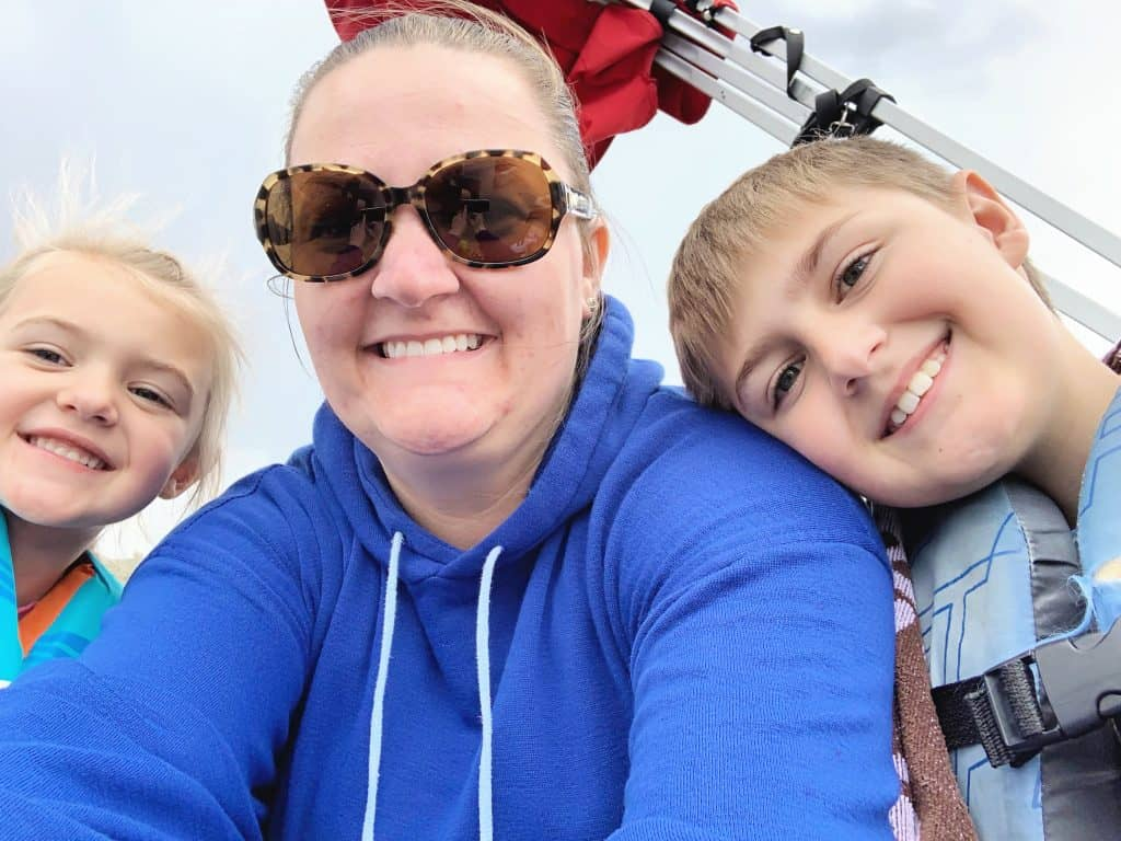 Mom and Kids on boat selfie