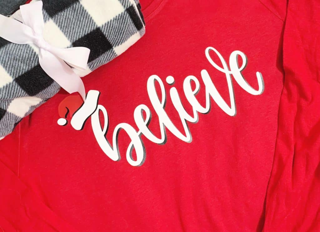 Believe holiday shirt on red