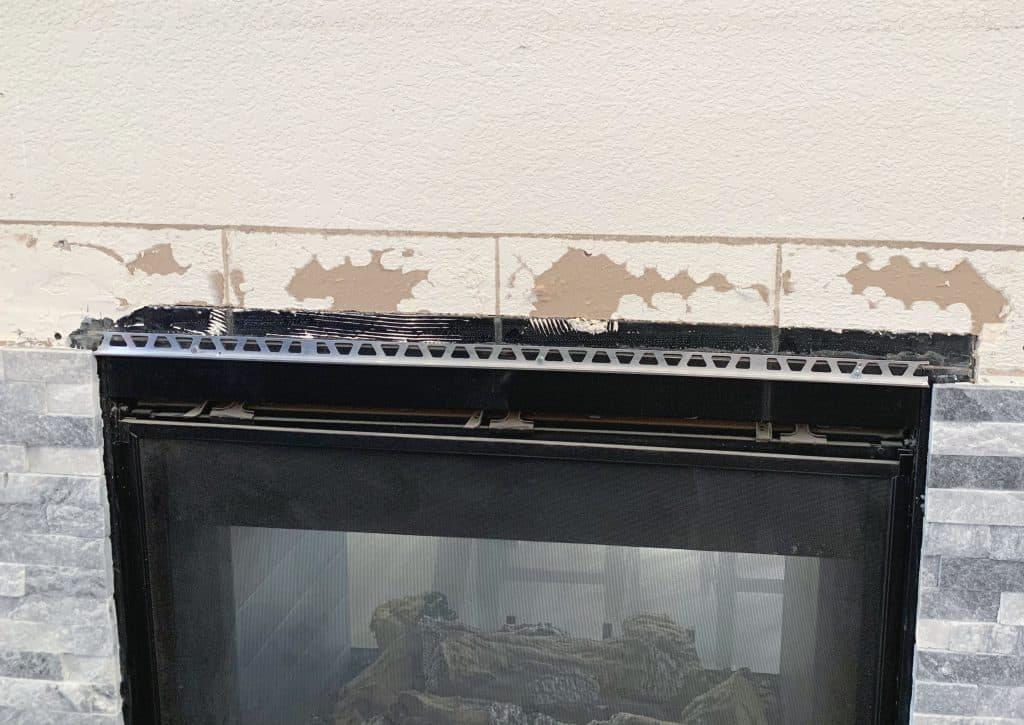 tile edging install on mantle