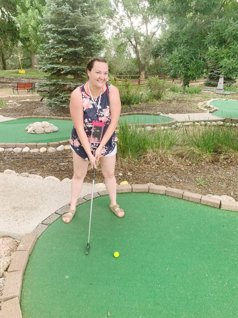Playing putt putt golf at KOA